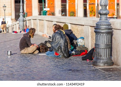 ROME, ITALY, on March 11, 2017. The group of the homeless sits on Ponte Sisto Bridge - the pedestrian bridge connecting the right coast of Tiber and the Region of Trastevere
