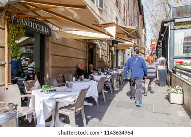 ROME, ITALY, on March 11, 2017. People eat and have a rest in cafe on the street in the downtown