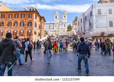 ROME, ITALY, on March 11, 2017. Tourists on Piazza di Spagna. Titular church Trinita dei Monty in the distance