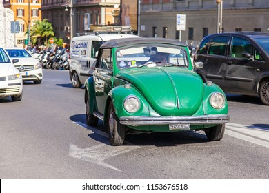 ROME, ITALY, on March 11, 2017. The beautiful picturesque street in a historical part of the city. The vintage car goes on the road