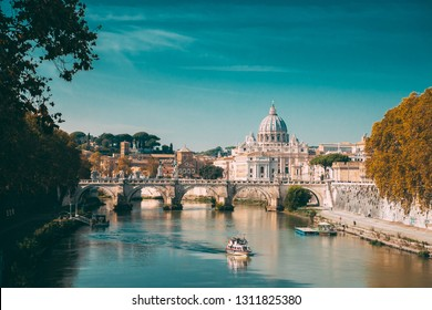 Rome, Italy. Papal Basilica Of St. Peter In The Vatican. Sightseeing Boat Floating Near Aelian Bridge. Tour Touristic Boat