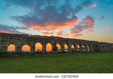 Rome (Italy) - The Parco degli Acquedotti at sunset, an archeological public park in Rome, part of the Appian Way Regional Park, with monumental ruins of roman aqueducts.
