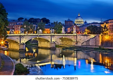 ROME, ITALY. Ponte Vittorio Emanuele II and Tiber river, as seen from Ponte Sant'Angelo. In the background the dome of St Peter's Basilica.