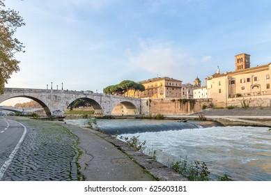 Rome, Italy. Quay of the Tiber, Chestio Bridge (46 BC), on the right - Tiberina Island