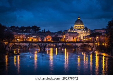 Rome, Italy. Saint Peter Church reflecting itself on Tevere river during the evening.