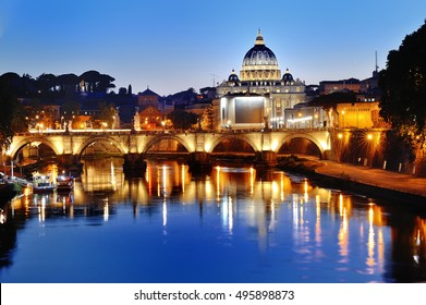 Rome, Italy - scenic view of the Tiber river and St. Peter's Basilica at night