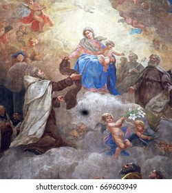 ROME, ITALY - SEPTEMBER 02: Virgin Mary with baby Jesus and Carmelite saints, ceiling of Santa Maria de Monte Carmelo Church in Trastevere, Rome. Trastevere, Rome, Italy on September 02, 2016.