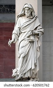 ROME, ITALY - SEPTEMBER 05: Saint Luke the Evangelist, statue in front of the basilica of Saint Paul Outside the Walls, Rome, Italy on September 05, 2016.