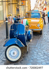 ROME, ITALY - SEPTEMBER 1, 2013: Old Italian Fiat 500 and the Vespa scooter parked on the street in Rome, Italy