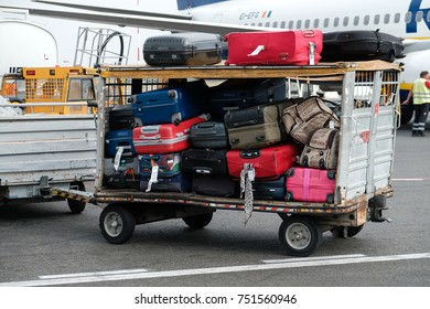 Rome, Italy - September 1, 2017: Cargo car carrying passengers' baggages to airplane