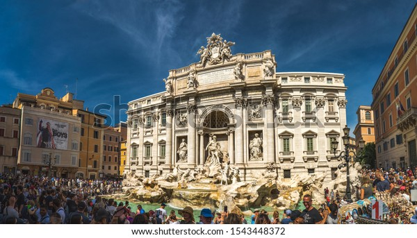 Rome, Italy - September 15 2019: Crowds of tourists near famous Trevi fountain in Rome, Italy. Crounds of people are making pictures and selfies in front of fountain di Trevi.