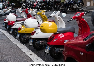Rome, Italy - September 2, 2017: Row of parked Vespa Piaggio scooters. Outdoors. Vespa is an Italian brand of scooter manufactured by Piaggio. The first Vespa was manufactured in the year 1946