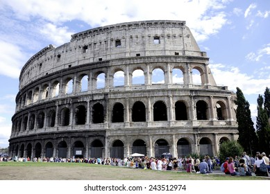 Rome, Italy - September 20, 2011: Tourists in front of the Colosseum at the Piazza del Colosseo in Rome.