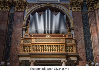 ROME, ITALY - September, 2018: view of interior detail of Basilica dei Santi Ambrogio e Carlo al Corso; pipe organ, Rome, Italy.