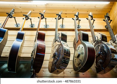 Rome, Italy. September 20th 2016.  Dobro guitars collection, rare different colors aligned hanging in store