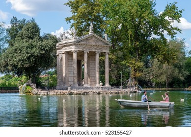 ROME, ITALY - SEPTEMBER 22, 2016: Couple enjoys the Villa Borghese lake on a sunny day