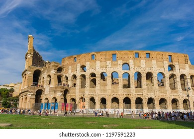 ROME, ITALY- SEPTEMBER 22, 2018: Unidentified people by Colloseum in Rome. It is most remarkable landmark of Rome and Italy. Colosseum is an elliptical amphitheatre in centre of the city of Rome.