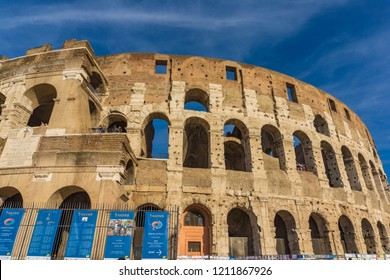 ROME, ITALY- SEPTEMBER 22, 2018: Unidentified people by Colloseum in Rome, Italy. It is most remarkable landmark of Rome. Colosseum is an elliptical amphitheatre in the centre of the city of Rome.