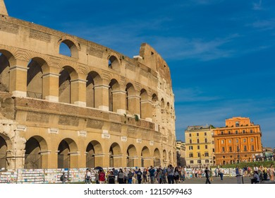ROME, ITALY- SEPTEMBER 22, 2018: Unidentified people by Colloseum in Rome.It is most remarkable landmark of Rome and Italy. Colosseum is an elliptical amphitheatre in the centre of the city of Rome.