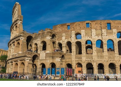ROME, ITALY- SEPTEMBER 22, 2018: Unidentified people by Colloseum in Rome. It is most remarkable landmark of Rome and Italy. Colosseum is an elliptical amphitheatre in the centre of the city of Rome.