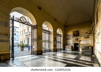 Rome, Italy - September 23 2017: The covered entrance of the Basilica di Santa Maria in Trastevere cathedral which looks into the busy piazza in Rome, Italy