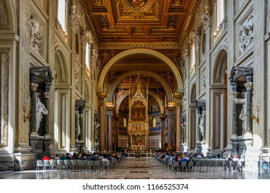 Rome / Italy — September 24, 2017: the interior of Archbasilica of St. John Lateran, or San Giovanni in Laterano, one of the four major papal basilicas in Rome, Italy, during a church service