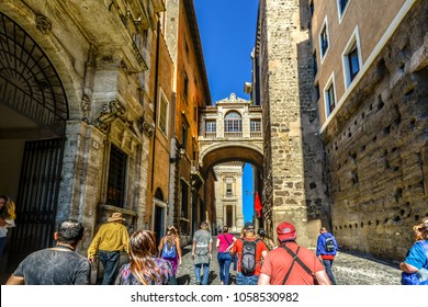Rome, Italy - September 26 2016: A tour guide leads a group of tourists through Capitoline Hill and the Portico dii Consentes near the Roman Forum on a sunny day in the heart of the historical center