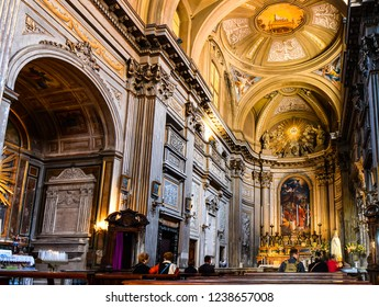 Rome, Italy - September 29 2018: Visitors marvel at the church interior apse, arches and naves of the basilica of Sant'Andrea Della Valle in the historic center of Rome, Italy.