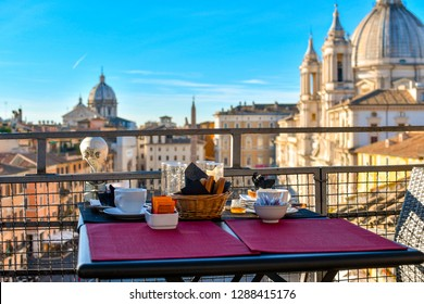 Rome, Italy - September 29 2018: Leftovers from a continental breakfast on a roof top bar overlooking the Piazza Navona on an early summer morning in Rome, Italy.