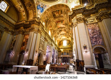 Rome, Italy - September 29 2018: The golden, ornately decorated interior napse, pews, dome and apse of the Basilica of Sant'Andrea della Valle in Rome, Italy.