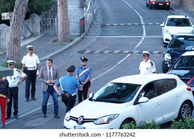 Rome, Italy - September 3, 2018: Italian carabinieri at work outdoors wearing the summer ordinary uniform. The Carabinieri corps is the fourth Italian military force charged with police duties