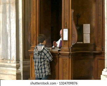 ROME, ITALY- SEPTEMBER 30, 2015: boy performing catholic confession at the basilica santa maria maggiore, rome