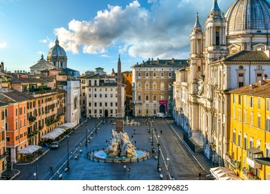 Rome, Italy - September 30 2018: View from a window overlooking the Piazza Navona early morning, showing the cathedral, sidewalk cafes, tourists and the fountain of the Four Rivers.