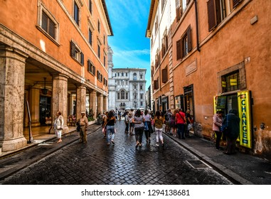 Rome, Italy - September 30 2018: Tourists head down one of the many alleys leading to the Piazza Navona in the historic center of Rome, Italy.