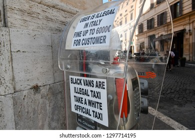 Rome, Italy - September 30 2018: A sign near a taxi station prohibiting the use of uber in the historic center of Rome, Italy.