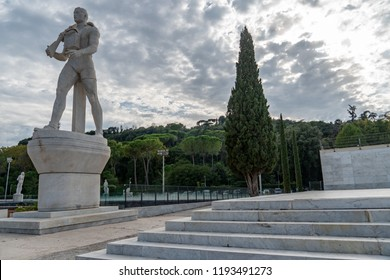 Rome, Italy - September 4, 2018: Marble statue of a modern soldier at the Foro Italico tennis court. Foro Italico, formerly Foro Mussolini, is a sports complex in Rome built between 1928 and 1938