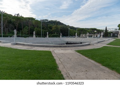 Rome, Italy - September 4, 2018: Marble statues at the Foro Italico tennis court. Foro Italico, formerly Foro Mussolini, is a sports complex in Rome built between 1928 and 1938