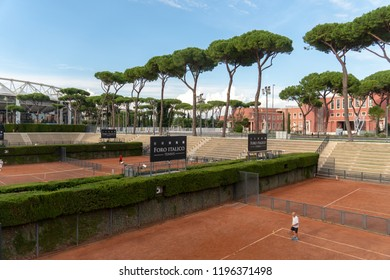 Rome, Italy - September 4, 2018: Unrecognizable player on Foro Italico red clay tennis court. Foro Italico, formerly Foro Mussolini, is a sports complex in Rome built between 1928 and 1938