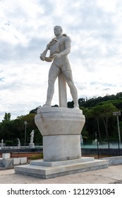 Rome, Italy - September 4, 2018: Marble statue of a modern soldier at the Foro Italico, formerly Foro Mussolini, a sports complex in Rome built between 1928 and 1938