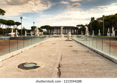 Rome, Italy - September 4, 2018: Marble statues of athletes outside the Stadio dei Marmi. The Stadium of the Marbles is a sport stadium in the Foro Italico, formerly Foro Mussolini, a sport complex