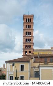 Rome, Italy, September 4, 2018: Basilica of Saint Mary in Cosmedin and fountain of Tritons in Piazza Bocca Della Verita,
