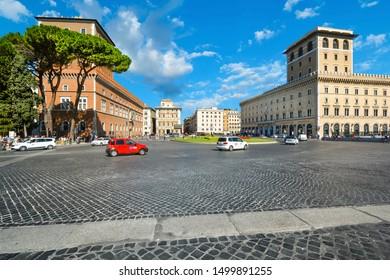 Rome, Italy - September 4 2018: The historic Palazzo Venezia behind an Italian stone pine tree on the piazza Venezia on a sunny day in Rome Italy