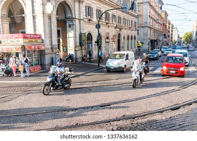 Rome, Italy - September 6, 2018: Italian street outside in city in morning road with shops stores near termini rail station and traffic with motorcycles