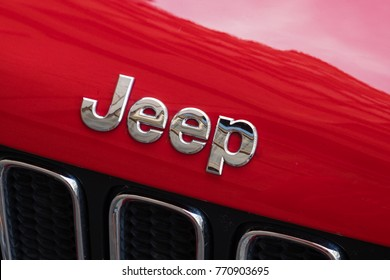 Rome, Italy - September 7, 2017: Jeep logo on red car. Jeep is a brand of American automobiles that is a division of FCA US LLC, a wholly owned subsidiary of Fiat Chrysler Automobiles