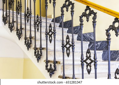 ROME, ITALY. Steps of a stone ladder and beautiful metal handrail. Fragment of an interior of the old building.