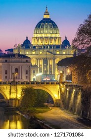 Rome (Italy) - The Tiber river and the monumental Lungotevere at sunset. Here in particular the Saint Peter basilica in Vatican
