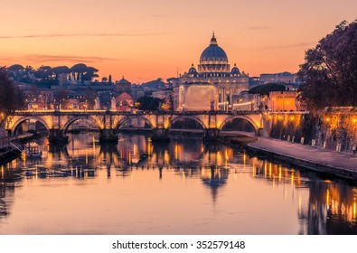Rome, Italy and Vatican City: St. Peter's Basilica, Saint Angelo Bridge and Tiber River at spectacular colourful sunset of Italian winter.