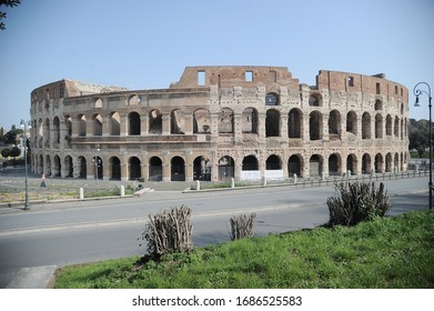 Rome, Italy-29 Mar 2020: Popular tourist spot Colosseum and Arch of Constantine is empty following the coronavirus confinement measures put in place by the governement, Rome, Italy