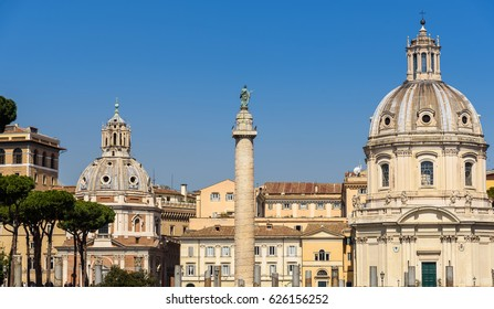Rome, italy-april 8,2017 - Colonna Traiana (Trajan's Column) and the church of Most Holy Name of Mary at the Trajan's Forum in Rome