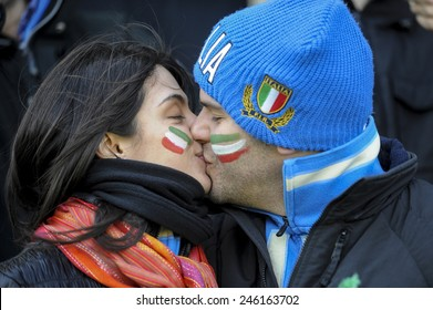 ROME, ITALY-MARCH 20, 2008: italian rugby fans couple kissing at the Flaminio stadium before the start of the rugby Six Nations match, Italy vs France, in Rome